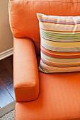 Detail of cushion on orange couch; Azusa; California; USA