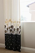 Patterned curtain at window; Murrieta; California; USA
