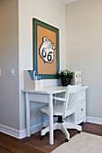 White office chair at table in study