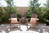 Wooden armchairs on sunny patio