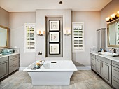 Free-standing, square bathtub in spacious bathroom; Rancho Mission Viejo; California; USA