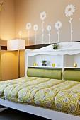 Bed with shelving in headboard; Valencia; California; USA