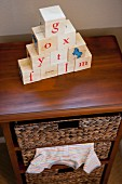 Alphabets blocks on chest of drawers in child's room
