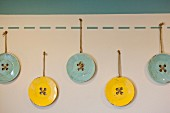Blue and yellow buttons hanging in child s room