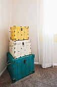 Stack of three chests in corner