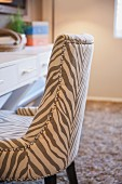 Detail of upholstered chair at table; Moreno Valley; California; USA