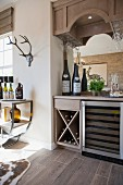Wine bottles in rack and on counter