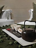 Detail of tea set on tray in bedroom