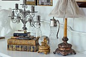 Antiquarian books, gilt snow globe with figurine of Mary and vintage-style table lamp