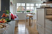 White kitchen-dining room wit oak floor in Swedish wooden house