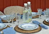 White and blue table settings on veranda