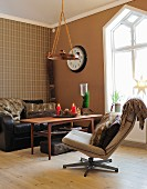 Rustic seating area in shades of brown with fur cushions and Advent arrangement on table