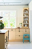 Pale kitchen counter with shell drawer handles
