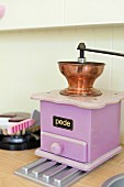 Purple coffee mill in toy kitchen