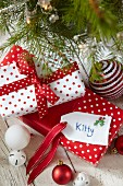 Wrapped Christmas presents with hand-crafted name tags
