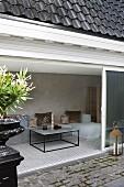 View from terrace through open sliding door into living room