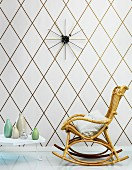 Diamond-patterned wallpaper and cane rocking chair