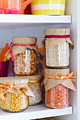 Storage jars with lids covered in brown paper