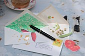 Vegetable seeds in envelopes labelled with matching paper motifs