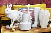 Various white vases and hare ornament on side table