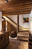 Wooden stairs and hallway furniture in old, restored farmhouse