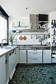 Modern, white, functional kitchen with terrazzo floor