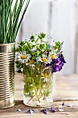 Edible wild flowers in drinking glass