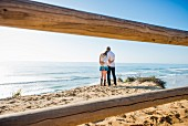 Romantic young couple on beach, Torrey Pines, San Diego, California, USA