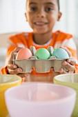 Boy dyeing Easter eggs