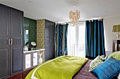 Bedroom with double bed and fitted wardrobes with integrated dressing table
