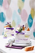 Small bag of bread with sprig of lavender decorating place setting