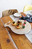 Cakes on wooden board or rustic wooden table