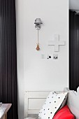 Cushions on bench against wall with Tolomeo wall-mounted lamp