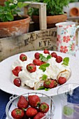 Swiss roll with strawberries and cream