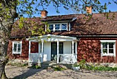 Swedish wooden house with white porch