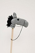 Hobbyhorse made from grey woollen socks with black wool mane