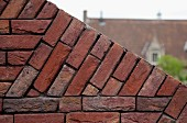 Detail of angled, brick garden wall