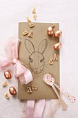 Hand-drawn card with Easter bunny, sugar eggs and pasta shaped like rabbits