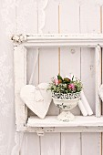 Wall decoration with love-heart & arrangement of roses and gypsophila