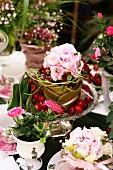 Summery arrangement of hydrangeas, roses and cherries