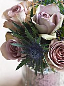 Posy of dusky pink roses and sea holly