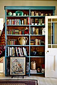Pale blue shelving against wall of rustic living room