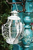 Nostalgic lantern hanging on DIY potting table