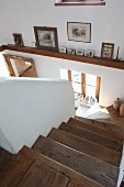 Stairwell with wooden treads and masonry balustrade