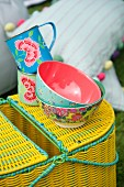 Bowls with floral patterns on yellow picnic basket