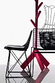 Wire mesh chairs, basket with wire frame and coat stand wrapped in pink cover