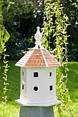 White bird nesting box in garden