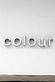 Decorative letters spelling 'colour' on wall