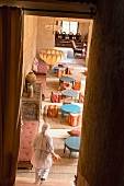 Small bistro tables and square stools on the covered terrace of the Beldi Country Club, hotel complex on the outskirts of Marrakesh, Morocco