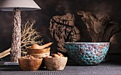 Various decorative wooden bowls and table lamp with wooden base